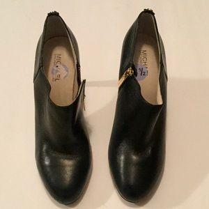 Michael Kors zipper heeled booties.